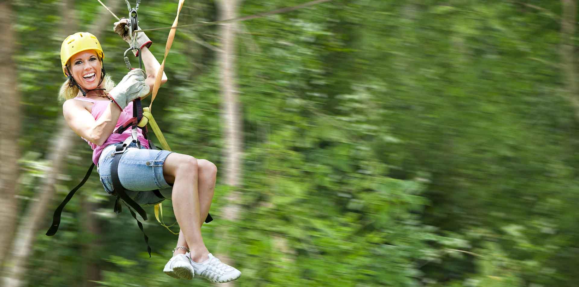 Woman Zip Lining in Costa Rica