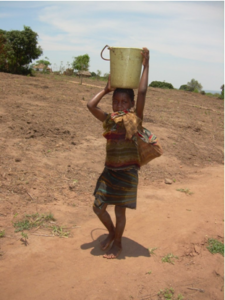 MOZ child carrying water