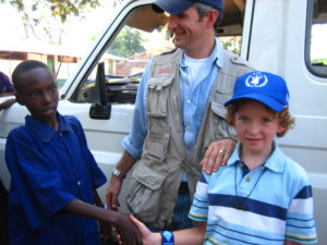FH International President Keith Wright in Northern Kenya with his son and another Kenyan boy.