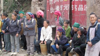 people waiting along roadside