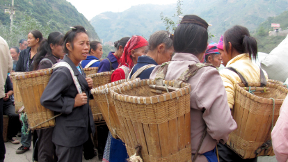 Women with baskets on their backs