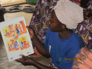 Mother-leader demonstrating improved hygiene practices