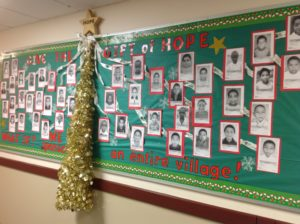 The Cherry Hills Middle School Hope Tree is decorated with the photos of children that the students have sponsored.