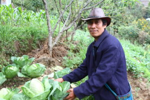 Organic agriculture can help farmers like these produce more while protecting the environment for future generations.