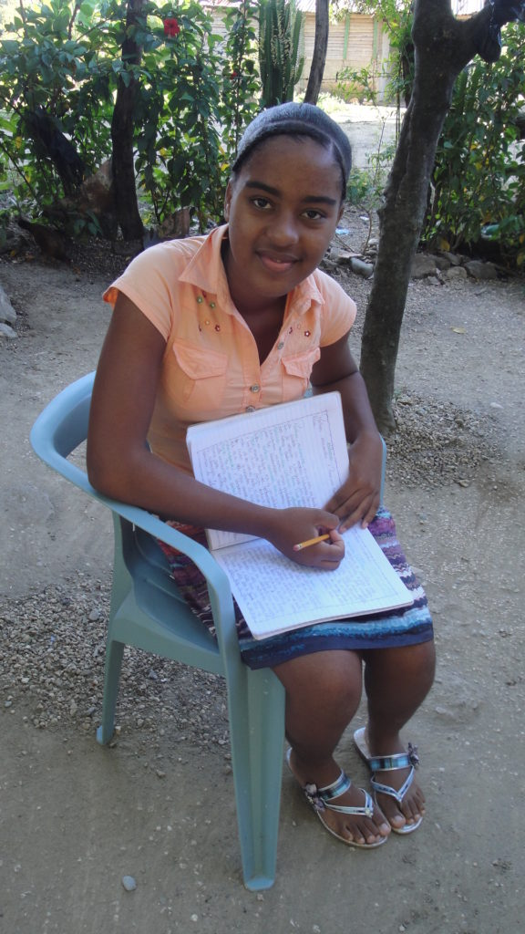 Girl in chair completing homework