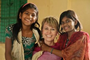 Heidi poses for a photo with Rakhi (left) and her sister Lota.