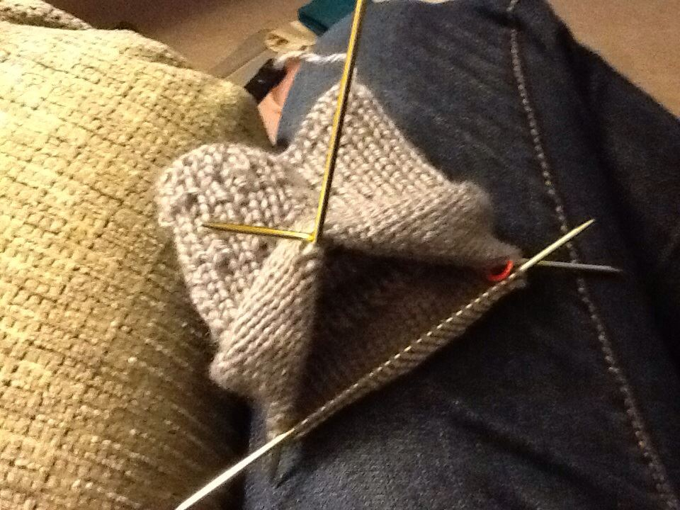 sock being made on double pointed knitting needles