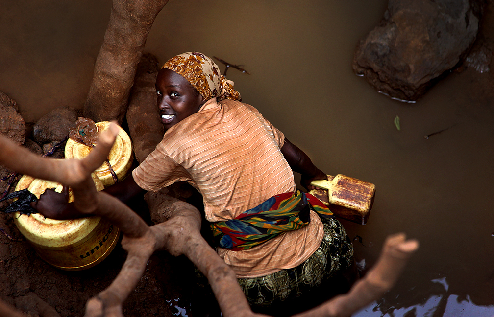 A woman fetches water in Africa