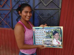 Karla holding her graduation keepsake