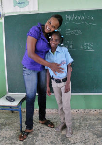Kenifer with her teacher