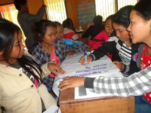 Teenage girls learn about the dangers and warning signs of trafficking in rural Cambodia.