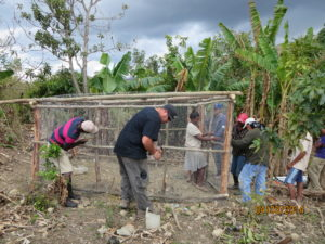 Sweat Hawgs and community members work together to build a chicken coop.