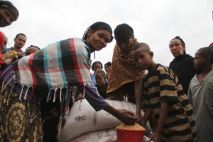 Ethensh and her children receive their monthly food supply.