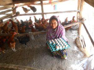 Rashida shows her chicken farm and eggs.