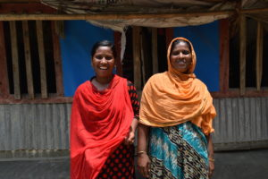Razia (left) with her mother, Parul outside of their home in Patuakhali, Bangladesh.