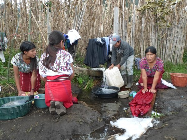 Women in Guatemala washing clothes at the water spout.