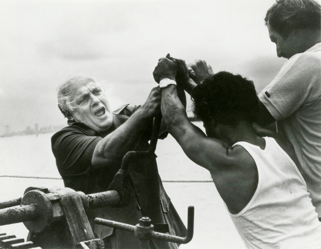 Dr. Ward, past FH executive, with Vietnamese boat people.