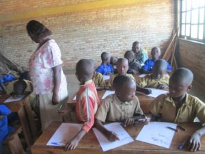 With the addition of a new classroom, almost all of the community's school children attend school.