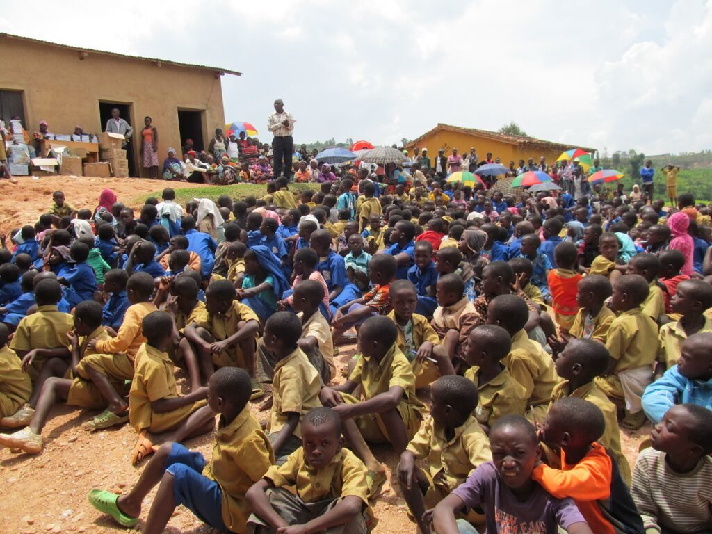 Thanks to generous donors and sponsors, these kids no longer have to crowd under a tree to try to learn.