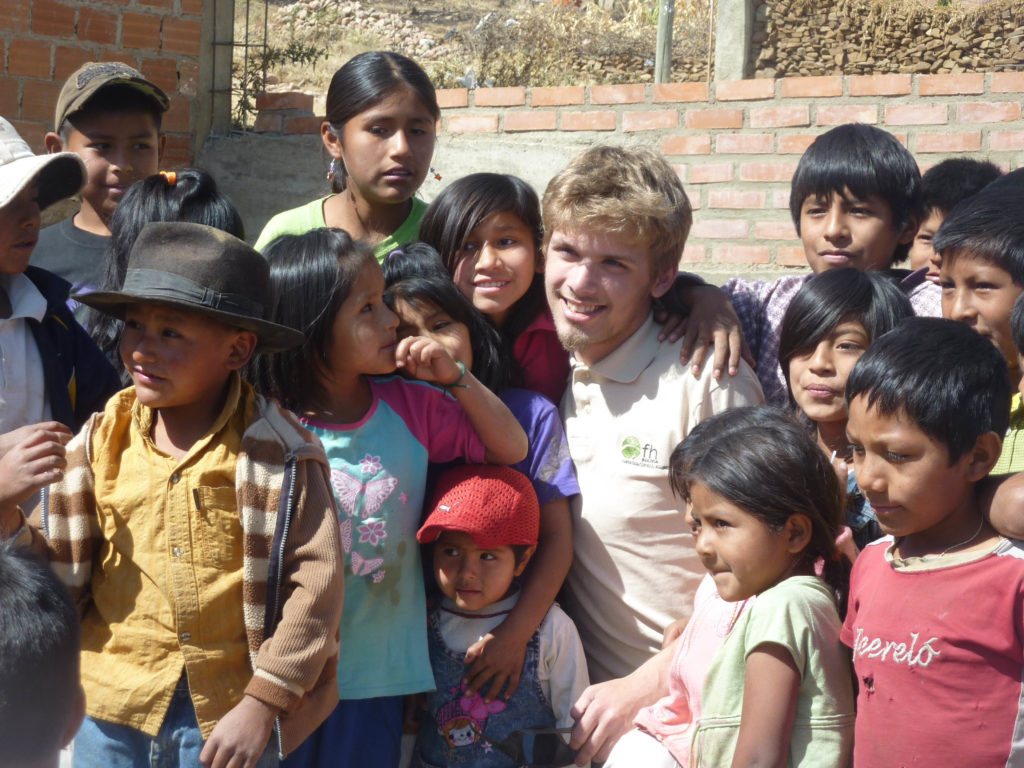 Anthony, a missions program member, and Bolivian children