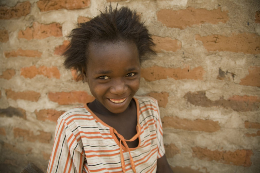 Corporate partnerships help children like this girl from Mozambique
