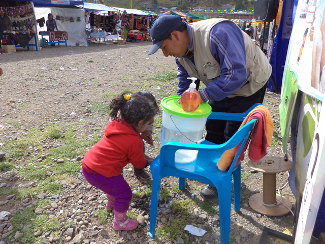 Raul with little girl in Peru