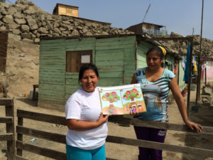 Catalina stands with Elsa, a woman from her group who she trained on non-violence in the home. Both women say the training has changed their families.