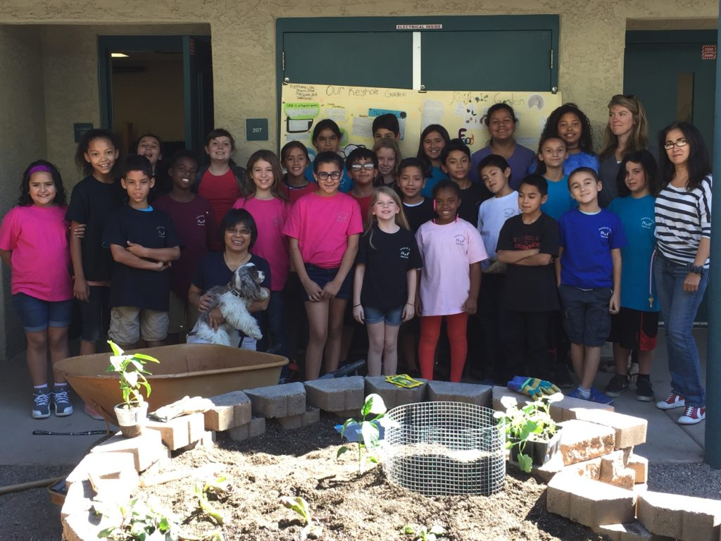 Elementary School Class With Their Keyhole Garden