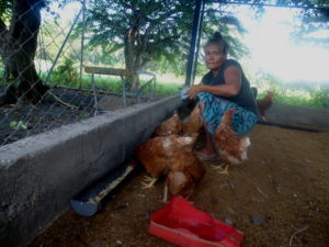 Lonsa Mejía with her chickens in El Porvenir, Nicaragua.