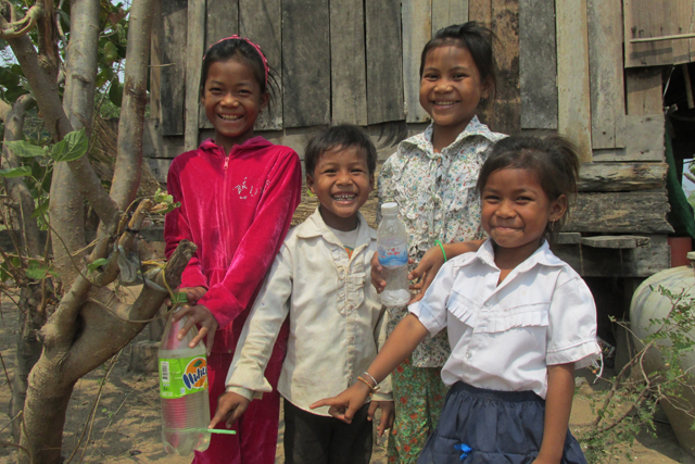 Children and their tippy tap in Cambodia