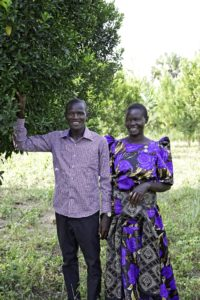 Alex and Ida on a farm made possible through child sponsorship