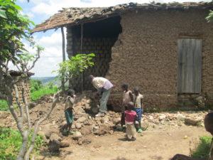 Family assessing flood damaged home