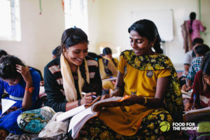 Two girls from FH's House of Palms in India, rescued from sex trafficking, read a book together