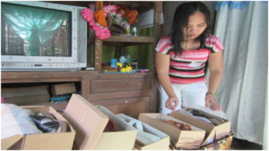 A single mom in the Philippines joined an FH savings group to start a small business of selling shoes