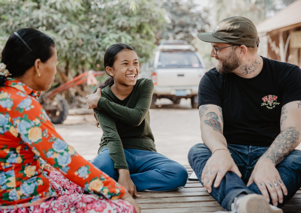 FH Creative Director Doug Penick meets sponsored child, Sopheap, in Cambodia.