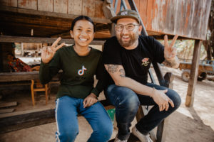 FH Creative Director and child sponsor Doug Penick and Sopheap, sponsored child, pose for a photo in Cambodia.
