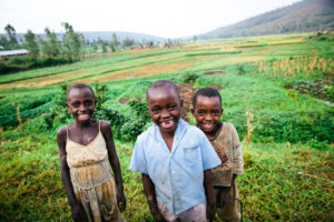 Three Children in Rwanda Smiling