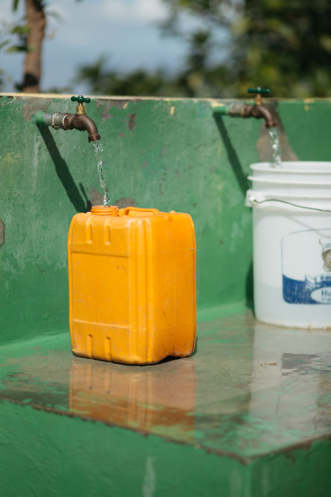 a jerry can being filled with water