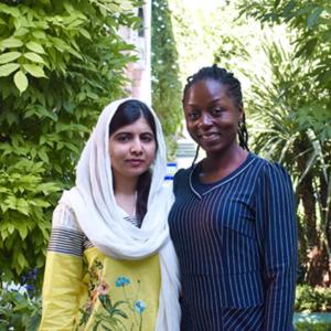 Malala Yousafzai and Frances Uchenna Igwilo standing together