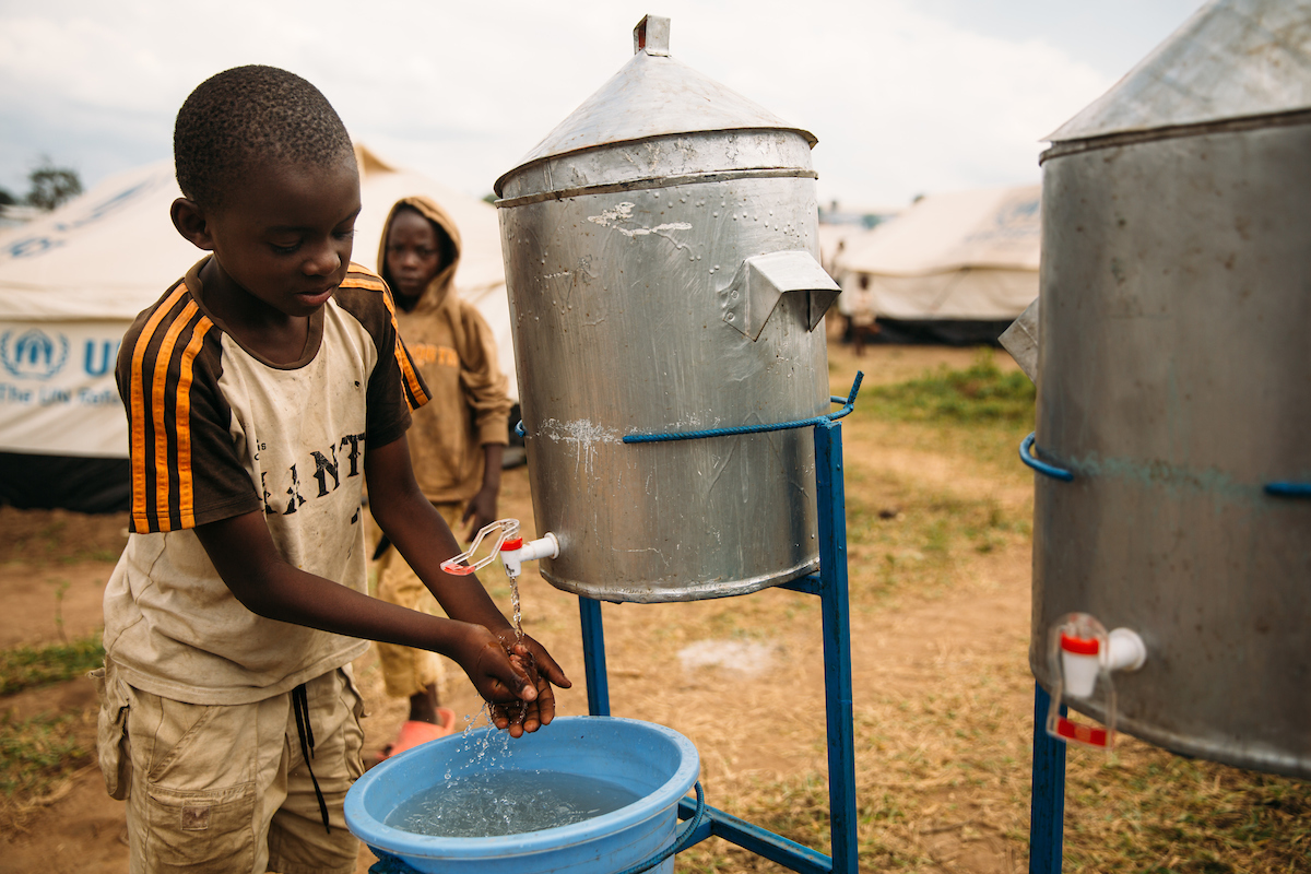 A young boy in Rwanda practices good handwashing habits!
