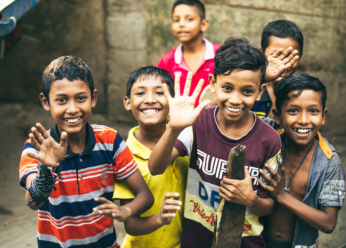 Sponsored children in Bangladesh smile for a photo
