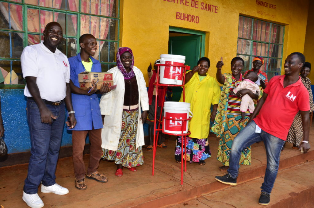 happy people receiving hand washing stations to fight covid-19