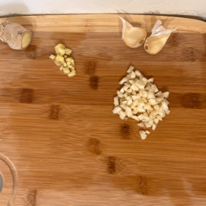 chopped ginger and garlic on a cutting board