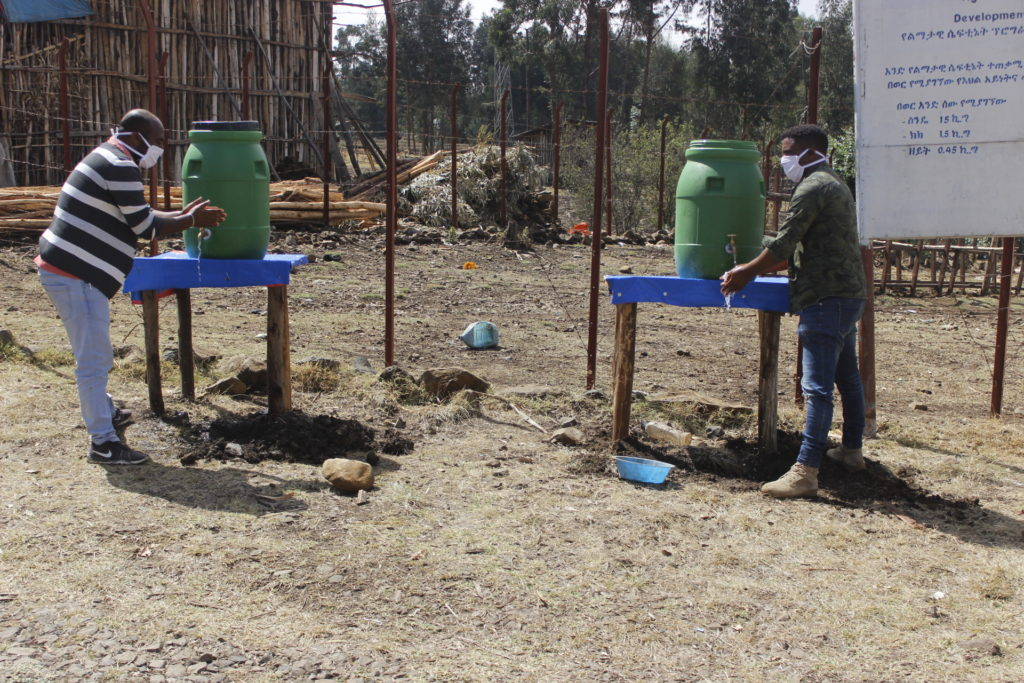 Beneficiaries using the handwashing stations
