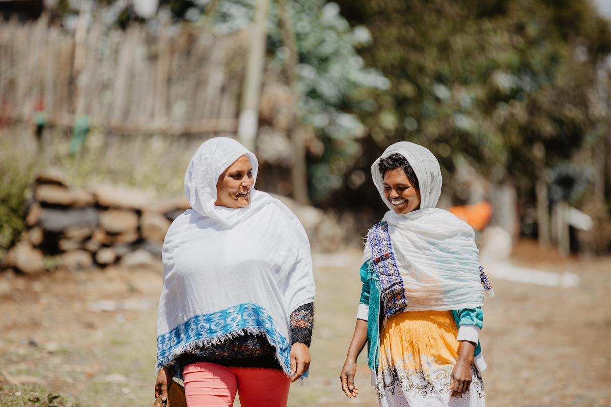 Sintayehu walks with an FH staff member.