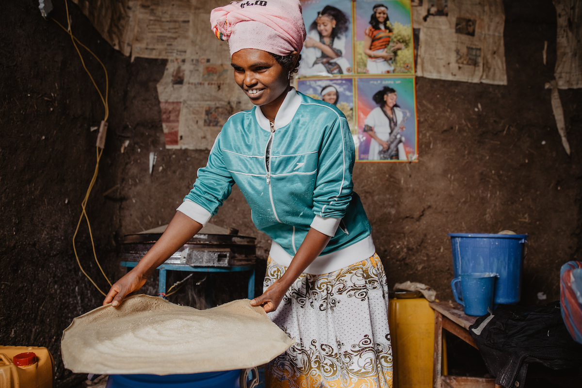 Sintayehu bakes injera bread for her business in Ethiopia.