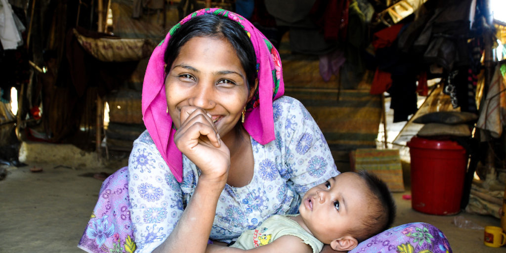 A mother holding her small baby in Bangladesh country.