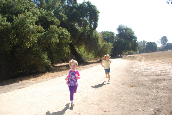 The kids are running like they're avoiding a mudslide or something, but really kids just like to be active outdoors.