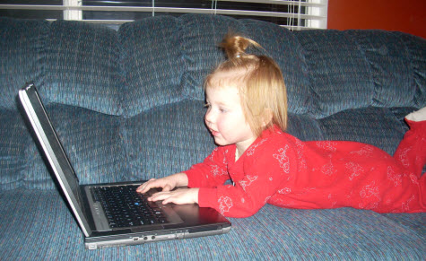 Lucy on the laptop at age 2.