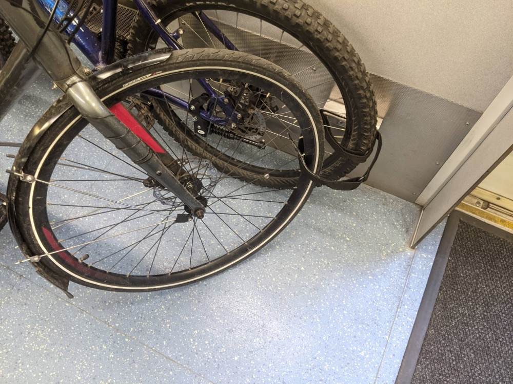 Securing your bike on the Sounder with flimsy velcro straps.